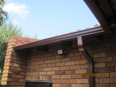 Completed Gutter with Down-pipe in Safari Brown.