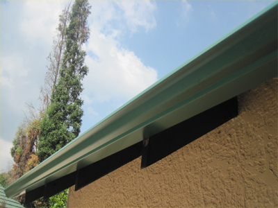 Gutter system - in Colonial Green.